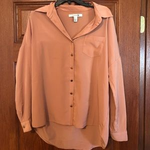 Long-sleeve neutral colored blouse